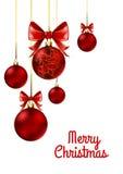 Bolas de la Navidad con la cinta y los arcos rojos Imagenes de archivo