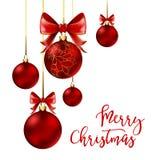 Bolas de la Navidad con la cinta y los arcos rojos Fotografía de archivo