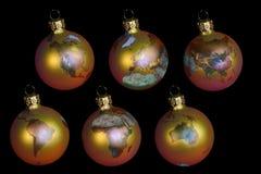 Bolas de la Navidad con tierra Imagen de archivo libre de regalías