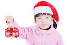 Bolas de la Navidad en la mano de la muchacha Imagenes de archivo