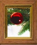 Bolas de la Navidad en marco Imagen de archivo