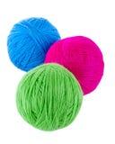 Bolas de lanas azules, rojas y verdes Fotos de archivo