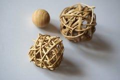 3 bolas de madera y de la paja Foto de archivo libre de regalías
