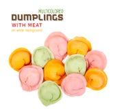Bolas de masa hervida multicoloras con la carne Foto de archivo libre de regalías