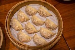 Bolas de masa hervida tratadas con vapor El dinar concedido estrella Tai Fung de Michelin se alinea como uno restaurante del top  fotos de archivo libres de regalías