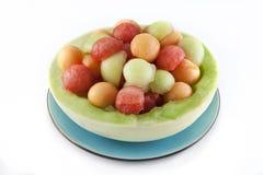 Bolas de melón en tazón de fuente de la ligamaza Imágenes de archivo libres de regalías