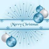 Bolas de Navidad y azul del resplandor solar Imagen de archivo