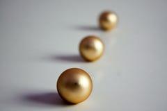 Bolas de oro fotografía de archivo
