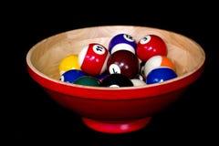 Bolas de piscina en tazón de fuente Foto de archivo