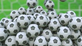 Bolas de queda do futebol contra o fundo do campo de grama rendição 3d Foto de Stock Royalty Free