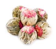 Bolas de té florecientes florales   Fotos de archivo