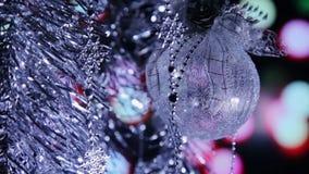 Bolas del Año Nuevo de la Navidad y luces fondo, primer del centelleo metrajes