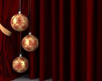 Bolas del Año Nuevo del oro delante de la pañería roja Imágenes de archivo libres de regalías