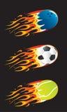 Bolas del deporte en fuego Foto de archivo libre de regalías