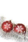 Bolas do Natal com os flocos de neve no ouropel Fotos de Stock Royalty Free