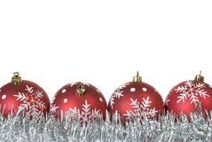 Bolas do Natal com os flocos de neve no ouropel Fotografia de Stock
