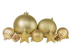 Bolas do Natal, estrelas e cone de abeto dourados Fotografia de Stock