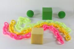 Bolas e cubos coloridos da esponja das correntes das estrelas Fotos de Stock