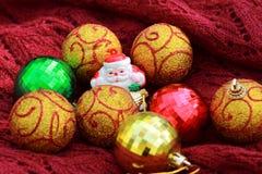 Bolas e Santa Claus Fotografia de Stock