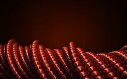 Bolas lustrosas vermelhas como a geometria 3D torceu formas circulares Fotografia de Stock Royalty Free