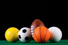 Bolas miniaturizadas del deporte   Imágenes de archivo libres de regalías