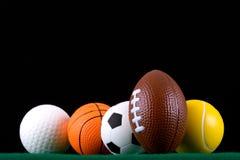 Bolas miniaturizadas del deporte   Foto de archivo