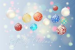 Bolas multicoloras de la Navidad con una enhorabuena apacible en la Navidad y la Feliz Año Nuevo Fotos de archivo libres de regalías