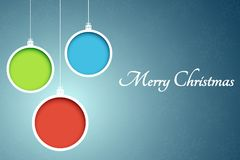 Bolas multicoloras de la Navidad Recortes de papel Banderas abstractas de la Navidad Copos de nieve en un fondo azul Vector Fotos de archivo