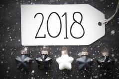 Bolas negras de la Navidad, copos de nieve, texto 2018 Imagenes de archivo