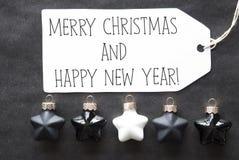 Bolas negras del árbol, Feliz Navidad y Feliz Año Nuevo Fotografía de archivo libre de regalías