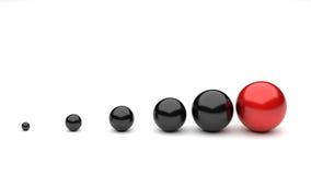 Bolas negras rojas del crecimiento Imágenes de archivo libres de regalías