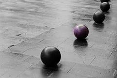 Bolas no pavimento Imagens de Stock