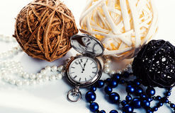 3 bolas, relógios e grânulos no fundo branco Fotos de Stock Royalty Free