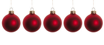 Bolas rojas de la Navidad aisladas en blanco imágenes de archivo libres de regalías