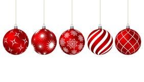 Bolas rojas de la Navidad con diversos modelos Foto de archivo libre de regalías