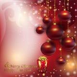 Bolas rojas de la Navidad en un fondo de la Navidad del resplandor Fotografía de archivo