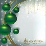 Bolas verdes de la Navidad en un fondo de la Navidad del resplandor Imágenes de archivo libres de regalías