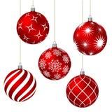 Bolas vermelhas do Natal com testes padrões diferentes Fotografia de Stock Royalty Free