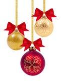Bolas vermelhas e amarelas do Natal com fita e curva Fotos de Stock Royalty Free