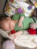 Bolas y bebé de las lanas Fotos de archivo