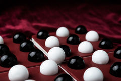 Bolas y huesos en los pozos, el símbolo del juego Fotografía de archivo