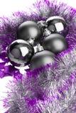 Bolas y oropel negros de la lila Imagen de archivo libre de regalías