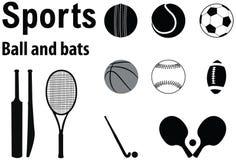 Bolas y palos de los deportes Fotos de archivo libres de regalías