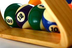 Bolas y triángulo de piscina Foto de archivo libre de regalías