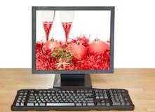 Bolas y vidrios rojos en la pantalla del PC de sobremesa Imágenes de archivo libres de regalías