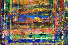 Bold blobs of paint scattered on canvas. Bright abstract painting of random lines and splotches of paint on the wall stock image
