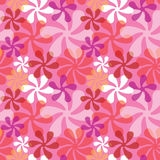 Bold Blossoms in Pink. Retro-style floral pattern in bright colors repeats seamlessly Royalty Free Stock Photo