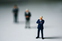 Bold decision. Miniature people thinking about some business things royalty free stock photos