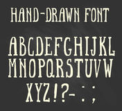 Bold hand-drawn font in the western style. Royalty Free Stock Photography
