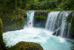 A bold Kayaker goes over the gushing Spirit Falls. A bold kayaker scales the gushing Spirit Falls in Washington royalty free stock photos